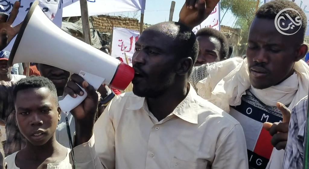 Kalma IDP megaphone man