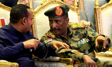 Sovereign Council HeadLt. Gen. Abdel Fattah el Burhan and Ethiopia Prime Minister Abiy Ahmed (Reuters)