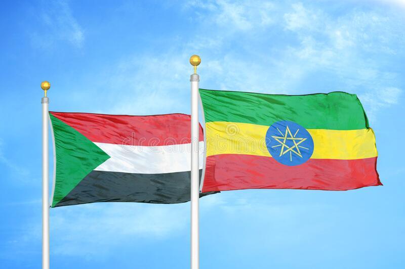 sudan-ethiopia-two-flags-flagpoles-blue-sky-sudan-ethiopia-two-flags-flagpoles-blue-cloudy-sky-background-192217874
